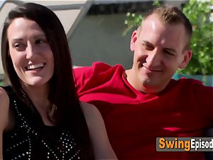 Swinger couple Matt and Alexis engage in make-out with other swingers
