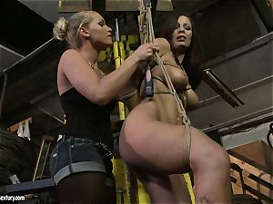 Kathia Nobili slapping the ass of hot damsel with cane