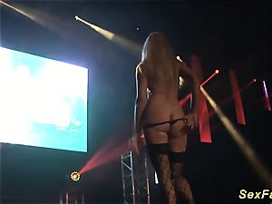 big-titted cougar undressing on public stage