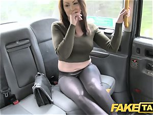fake taxi warm Australian black-haired in high-heeled shoes