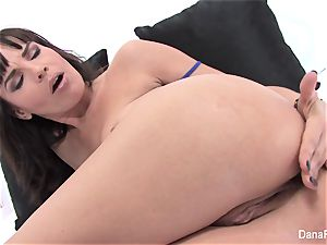 porn industry star Dana stretches her brown-eye with a meaty fucktoy