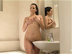 Katty tends to her globes
